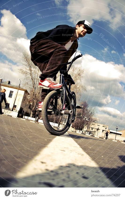 bmxzone.ru man #2 BMX flatland building Fahrrad noon outdoor shooting town