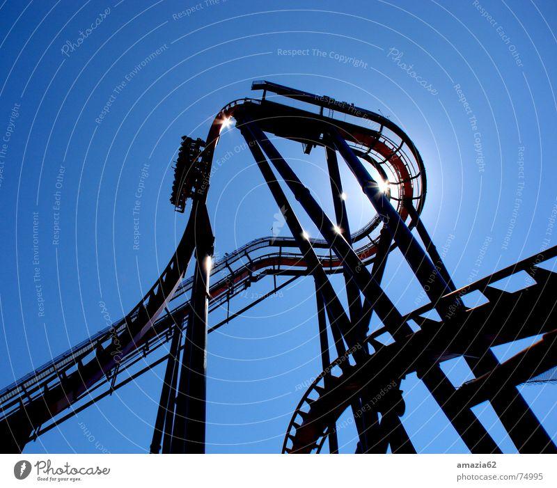 SheiKra Achterbahn Florida Aktion Licht rollercoaster Himmel blau schlangenförmig