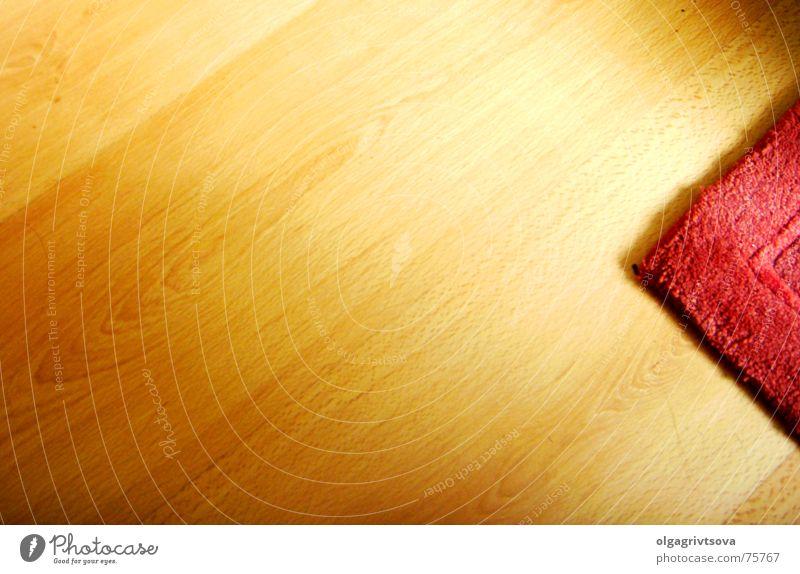 Zeig mir nichts! rot gelb braun orange leer weich Bodenbelag Pfeil Teppich Parkett links zeigen