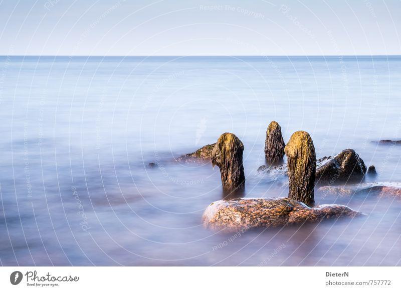 Relikte Landschaft Wasser Sonnenlicht Küste Strand Ostsee Meer blau gelb Buhne Stein Langzeitbelichtung Horizont Himmel Farbfoto Außenaufnahme Menschenleer