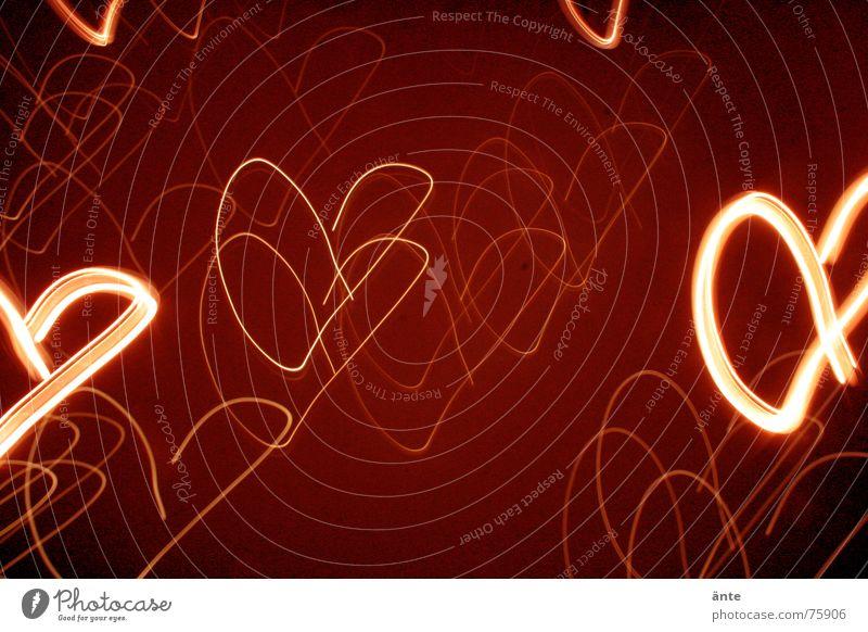 verliebt? Valentinstag liebste Muttertag blind Liebkosen allerliebst Güte Licht Langzeitbelichtung Unschärfe rot Nacht Bewegung Freundschaft Nachtaufnahme