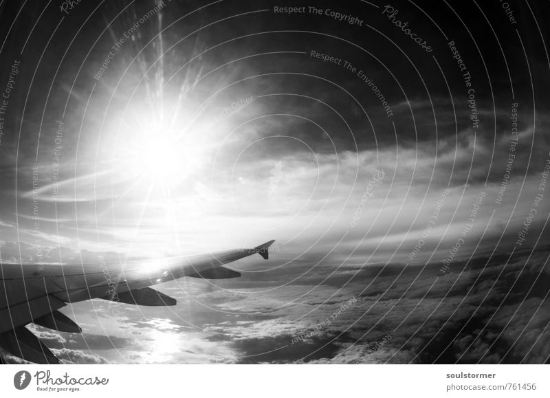 Enter the new world... Ferien & Urlaub & Reisen Abenteuer Ferne Freiheit Himmel Wolken Sonne Sonnenlicht Wetter Luftverkehr Flugzeug Flugzeugausblick Vorfreude