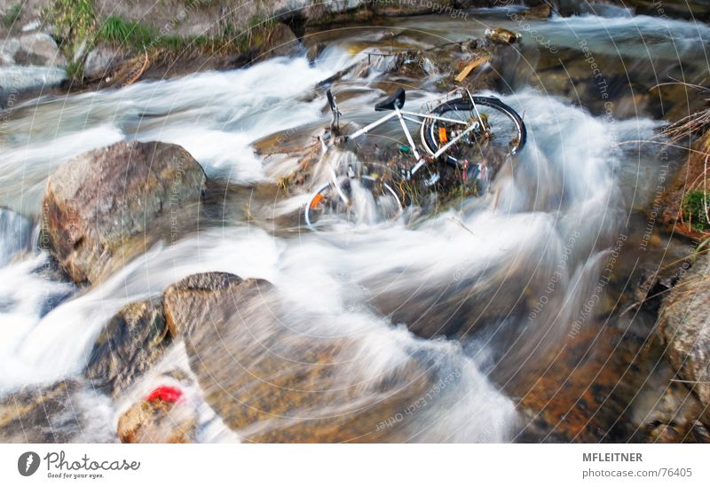 there is a bicycle in the river Bundesland Tirol Österreich water austira Fahrrad Fluss Wasser motion tyrol