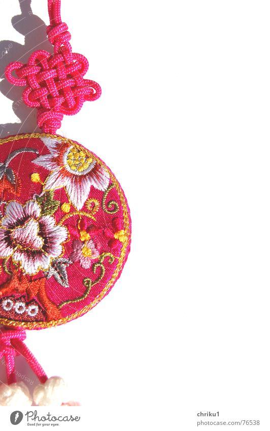Anhängsel Stoff rosa Schlüsselanhänger mehrfarbig Schnur durcheinander knallig Muster Außenaufnahme Asien Kitsch tand Knoten Makroaufnahme