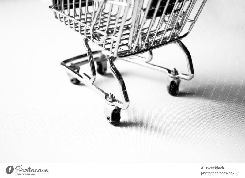 Einkaufstransportfahrzeug (2) Einkaufswagen Ladengeschäft Supermarkt Wagen Eisen Korb Konsum Metall einkaufstransportfahrzeug Einkaufskorb
