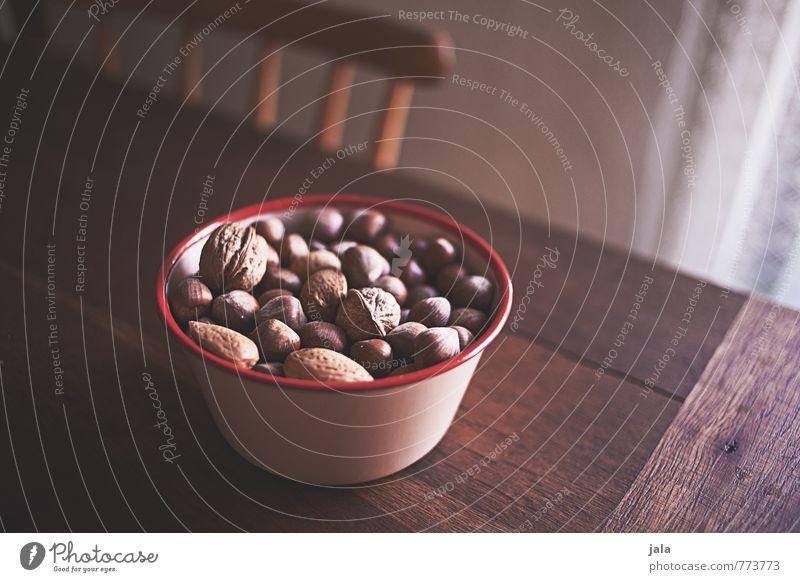nüsse Lebensmittel Nuss Fingerfood Schalen & Schüsseln Stuhl Tisch Holztisch Gesundheit lecker natürlich Appetit & Hunger Gesunde Ernährung Farbfoto