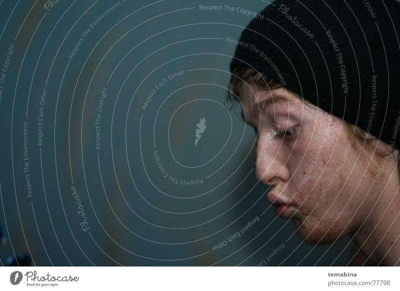 Boy on Blue negativ boy man Schnur looking down space freckle thinking creative
