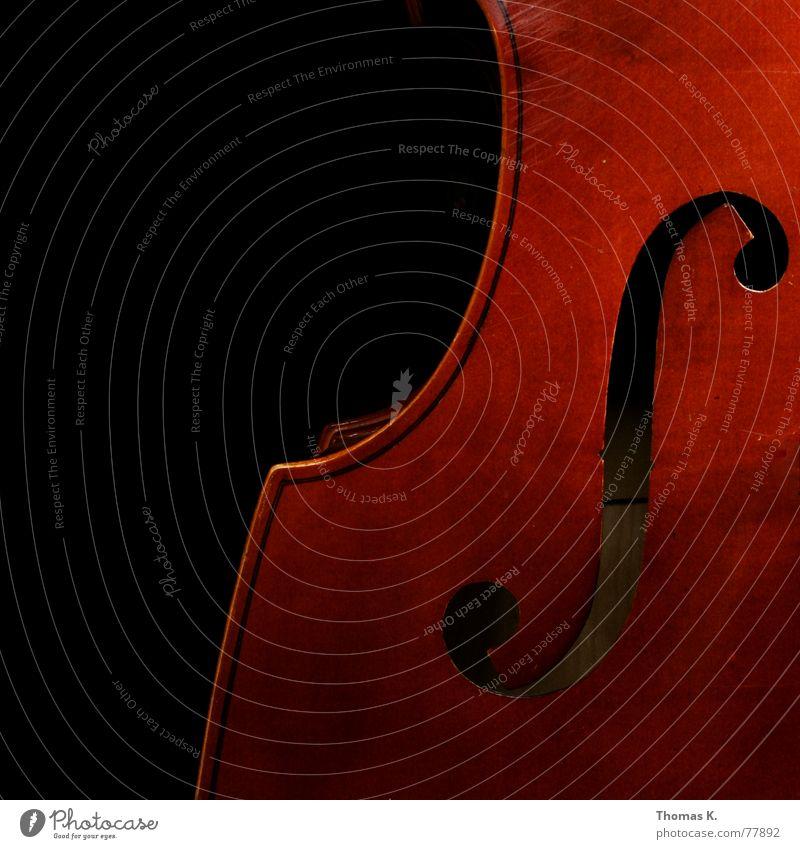 Das F-Loch rot schwarz dunkel Spielen Holz Musik braun hören Konzert Loch Radio Musikinstrument singen Klang Lied Swing