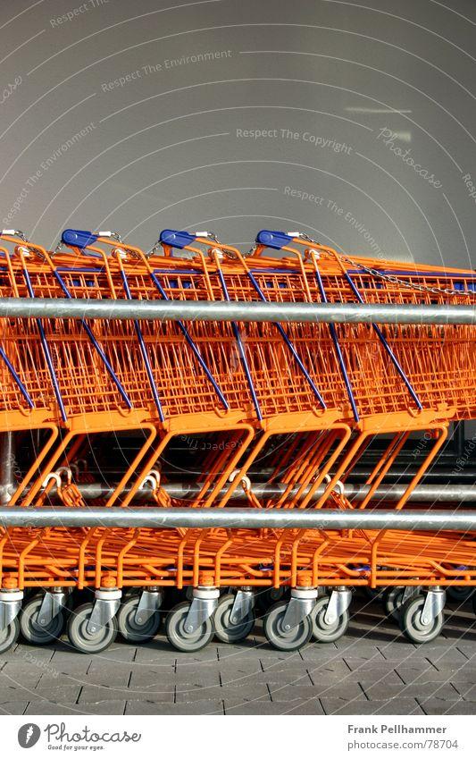 DER EINKAUFSWAGEN Einkaufswagen Rolle Stab Plus Wagen einfach obskur orange blau