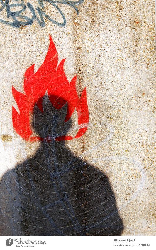 Hitzkopf Mensch Mann Stadt rot schwarz Wand Mauer Wärme Brand Beton Physik heiß Flamme Warnhinweis anzünden Warnschild
