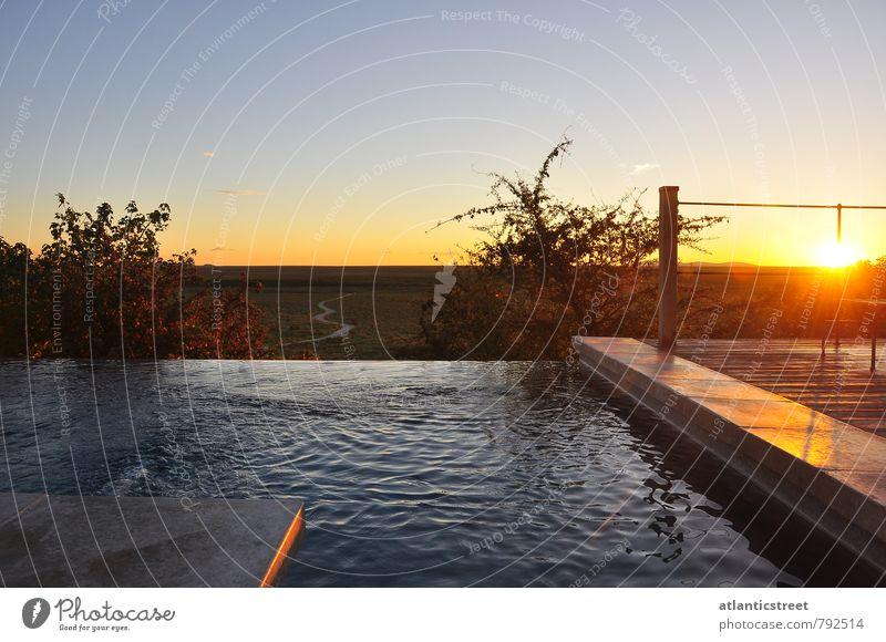 Sonnenuntergang im Etosha-Park Ferien & Urlaub & Reisen Sonne Einsamkeit Erholung ruhig Ferne Schwimmen & Baden Freiheit Stimmung Horizont Idylle Tourismus Schönes Wetter Abenteuer Wolkenloser Himmel Afrika