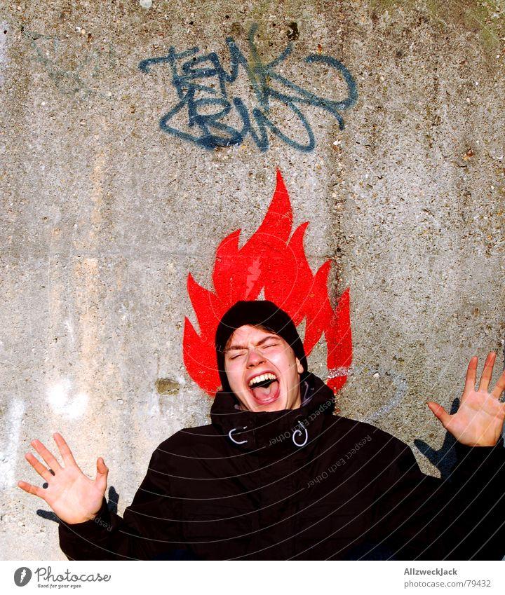Pumuckl die Zweite Mann Wand Mauer Symbole & Metaphern schreien anzünden Hand rot Porträt Kopfschmerzen Junger Mann zündeln Brand Angst Panik gefährlich