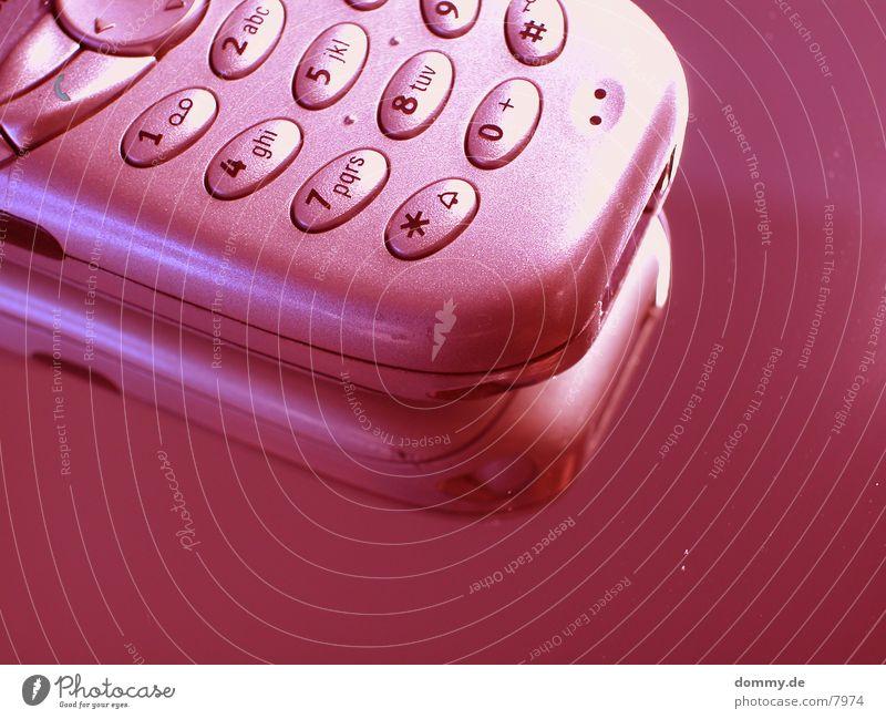 redTelefonzelle rot Handy Makroaufnahme Nahaufnahme kaz