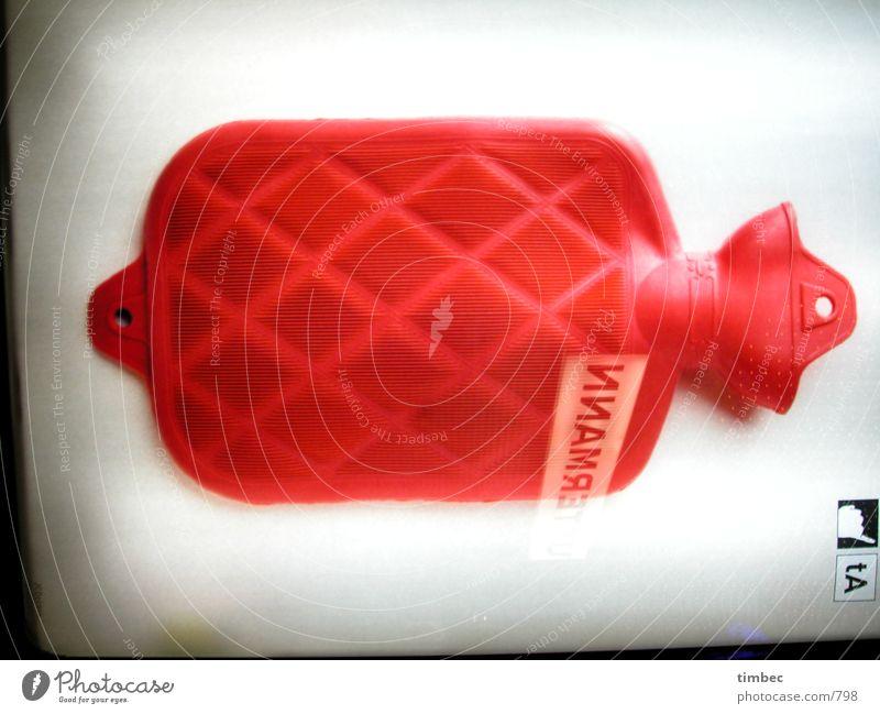 Warmhalter rot Wärme Beleuchtung Gesundheit liegen Häusliches Leben Symbole & Metaphern Mitte Werbung Theaterschauspiel erleuchten Geborgenheit Plakat zentral
