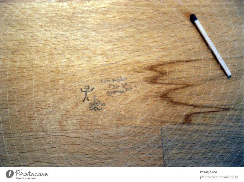Cast Away Streichholz Tischplatte braun gezeichnet Strichmännchen Holz zündeln anzünden brennen Rascheln Freude Feuer Brand etnzündlich Maserung Flamme happy