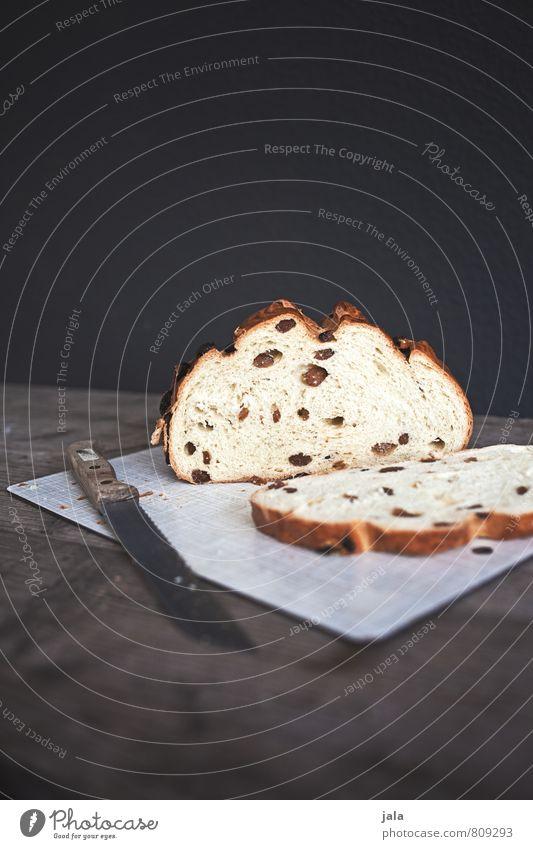süßer stuten Kuchen Hefekuchen Rosinenkuchen Ernährung Kaffeetrinken Bioprodukte Vegetarische Ernährung Messer Schneidebrett frisch lecker natürlich