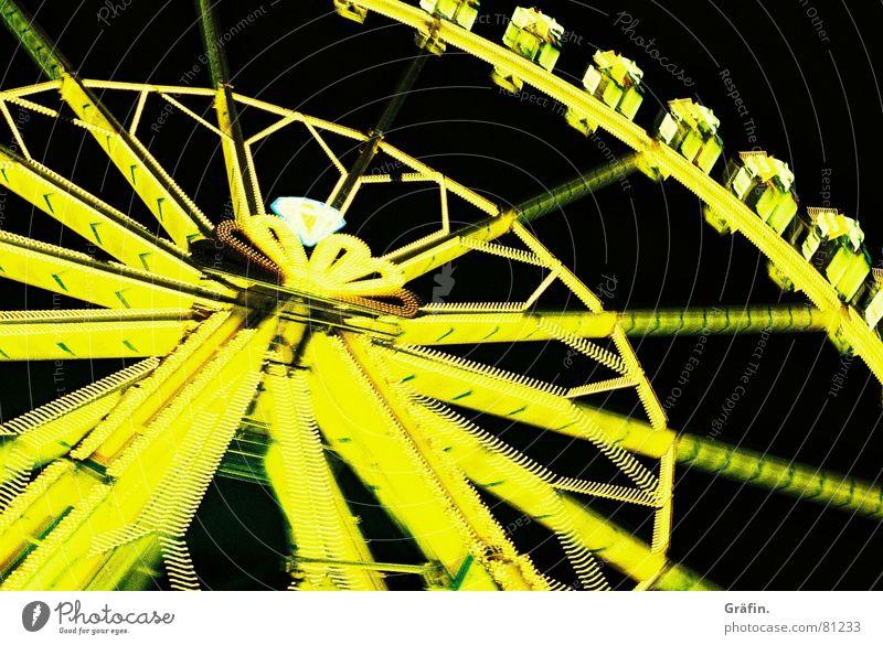 immer schön im Kreis gelb Bewegung Feste & Feiern Jahrmarkt Neonlicht Oktoberfest Riesenrad Schützenfest