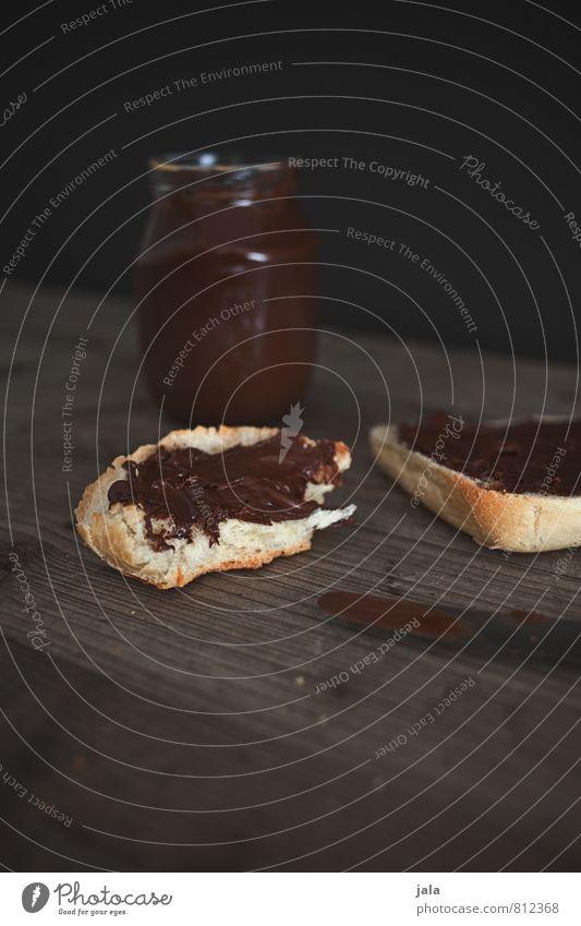 nougatcreme dunkel natürlich Lebensmittel Glas Ernährung süß Süßwaren lecker Appetit & Hunger Bioprodukte Frühstück Messer Schokolade Brötchen