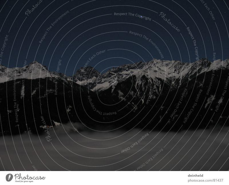 Wolkenmeer mit Bergen Winter Schnee Berge u. Gebirge Stern Nebel Belichtung