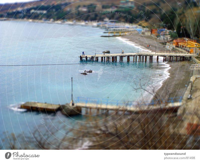 Semi-artificial beach Wasser Meer blau Strand Ferien & Urlaub & Reisen träumen Landschaftsformen hell Küste Freizeit & Hobby Hafen Anlegestelle Schönes Wetter