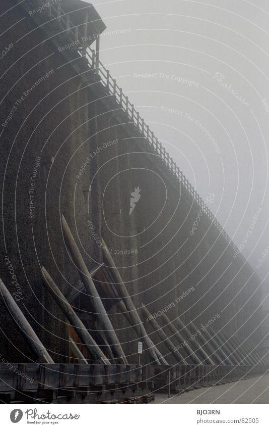 'ne Schwarzdornwand dunkel Wand Holz Stein Traurigkeit Luft Deutschland Nebel hoch Technik & Technologie Tor Denkmal feucht Kies Salz Dezember