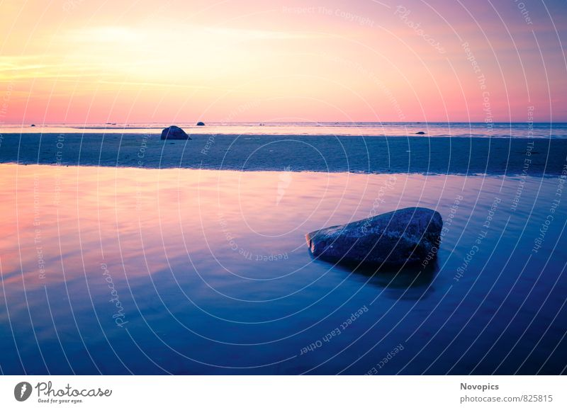 Baltic Sea sunset on the island Poel ruhig Ferne Sonne Strand Meer Wellen Natur Landschaft Wolken Sommer Felsen Ostsee Stein Sand Wasser blau gelb violett rot