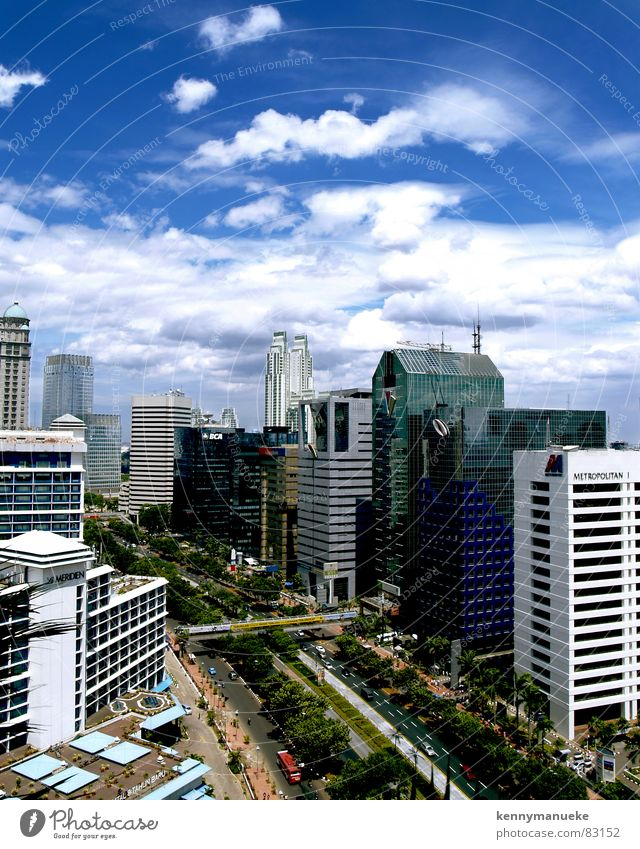 Jakarta's Scrapers Stadt capital city Indonesia buildings main road clouds noon office buildings