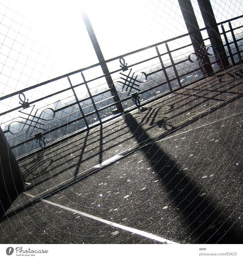 eiffel and sun Tour d'Eiffel Paris Schlagschatten Licht Gegenlicht Aussicht Geländer Gitter Asphalt Pause Schattenspiel Ornament Wahrzeichen Denkmal lichtmoment