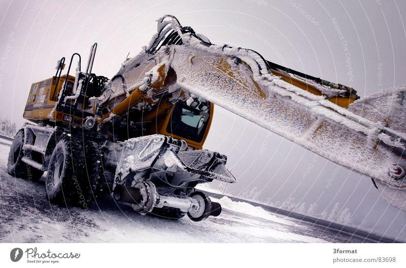 bagger03 Winter ruhig kalt Schnee Eis Kraft Macht Baustelle Gewalt Maschine bewegungslos hart extrem Bagger Koloss