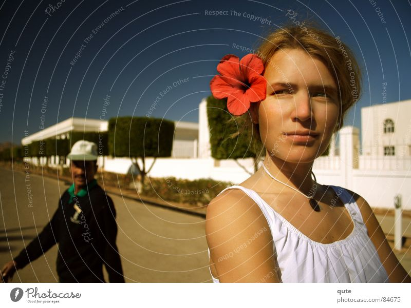 She's got the look Blume Mann Frau flower red arabian streetscape Egypt noon