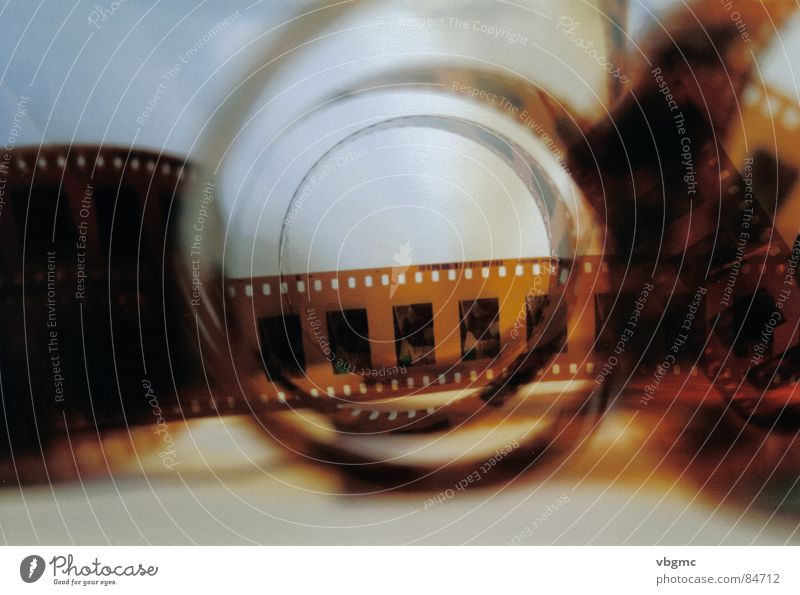The wonderful world of 35mm Fotografie old-school Medien Filmindustrie Filmmaterial braun Kino Theater roll pondering filmroll movie film kunstlich artistic