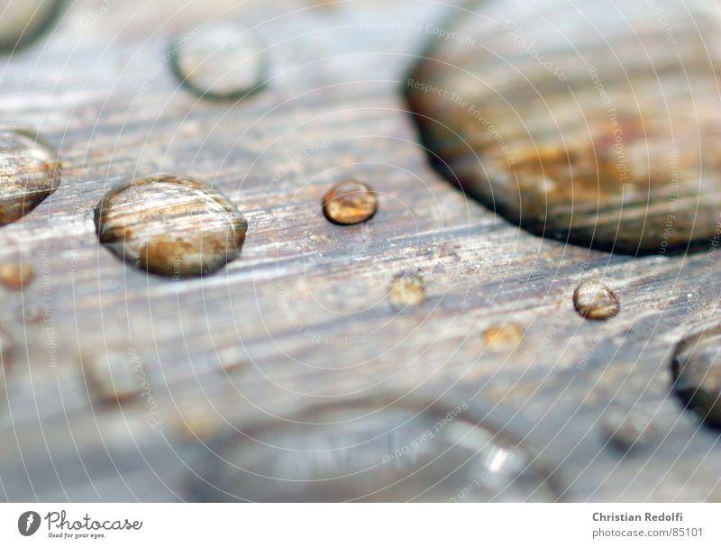 Tröpfchen Wasser ruhig Wassertropfen Schifffahrt Stillleben Eisen Lupe Laufwerk vergrößert Kratzer hydrophob