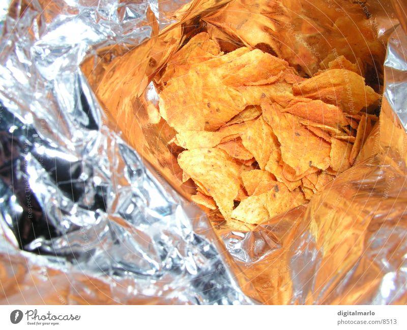 chipstüte Ernährung Metall orange glänzend Fernsehen Kräuter & Gewürze Scharfer Geschmack Fett Mikrochip salzig