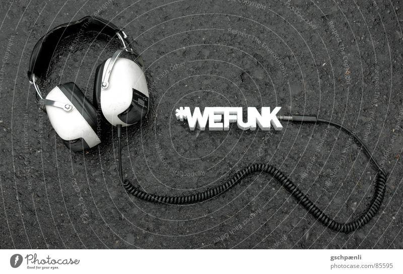 You Rock, We Funk // one Straße Stil Musik Kunst trist stehen Bodenbelag liegen Asphalt Konzert Verbindung Typographie Kopfhörer Leitung früher Lied