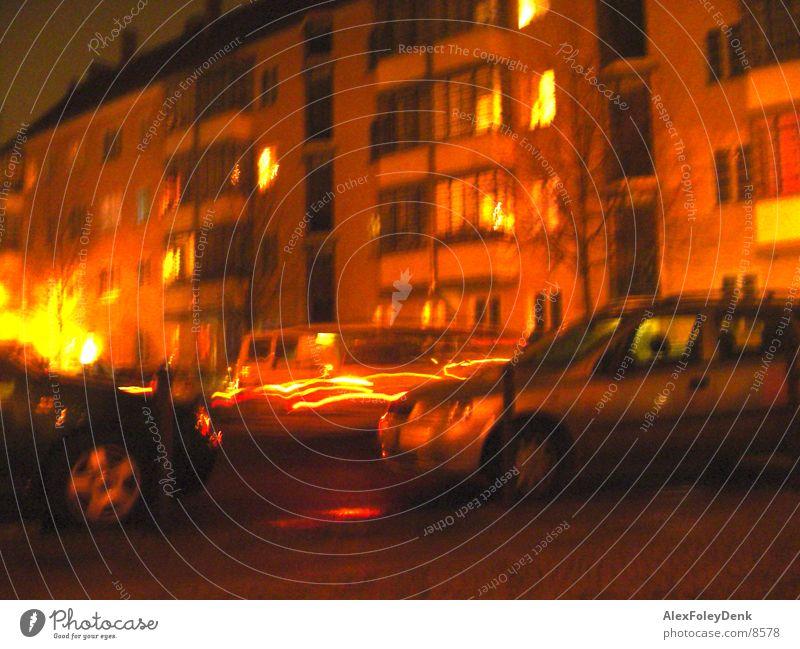 House Lights Lichtspiel Langzeitbelichtung Haus Wand orange Abend Straße