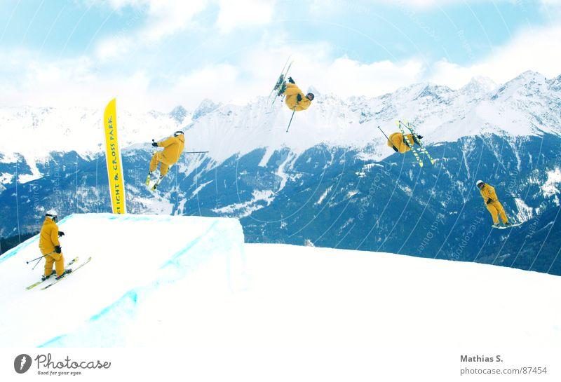 Underflip 720° Sonne Wolken Freude Berge u. Gebirge gelb Schnee Stil Sport fliegen springen Freizeit & Hobby Luft hoch Körperhaltung Alpen Schneebedeckte Gipfel