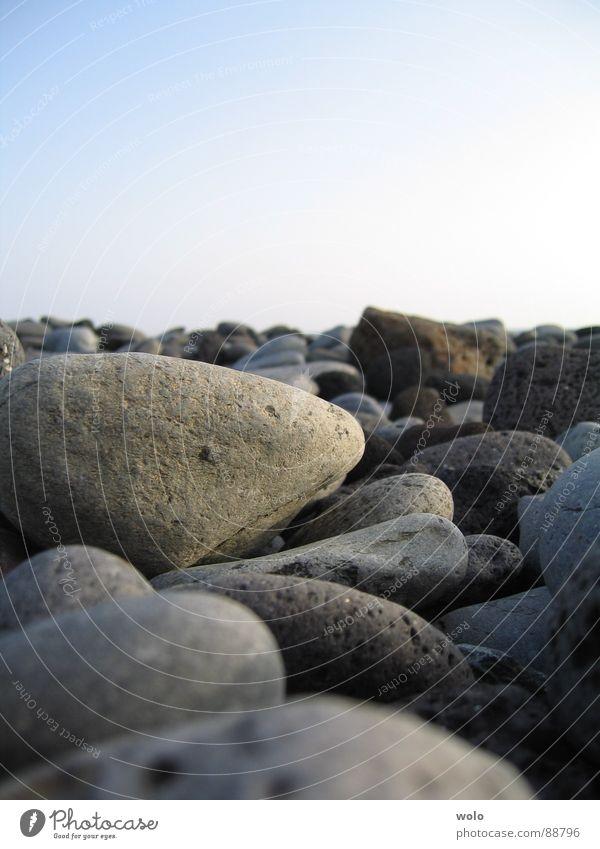Stone Strand Teneriffa Ferien & Urlaub & Reisen grau Kieselsteine Küste Stein Mineralien Himmel blau