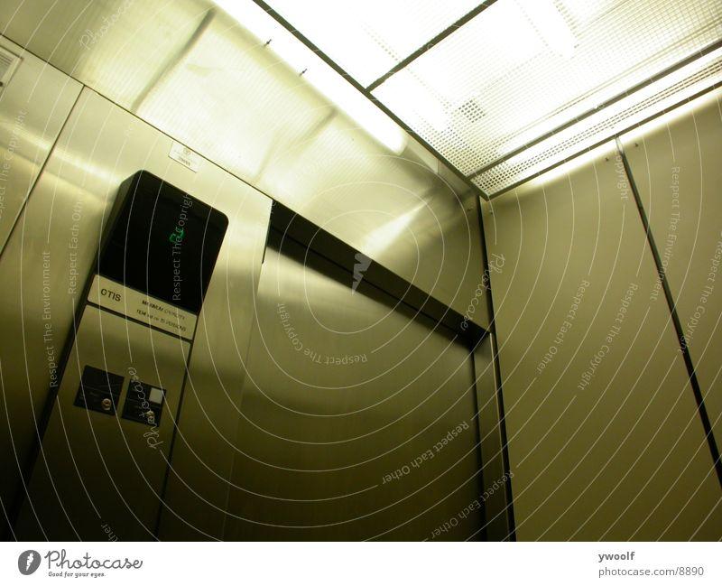 Aufzug Elevator I Fahrstuhl 2 Verkehr stainless steel flourescent light grid