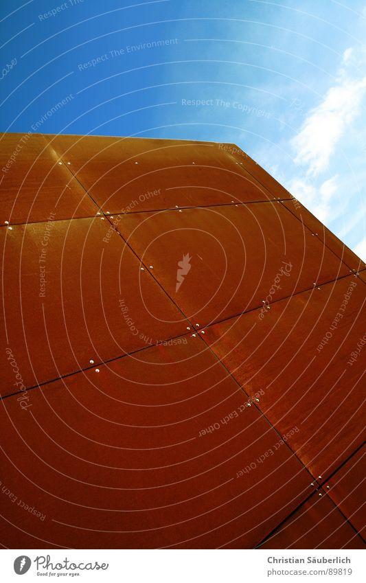 SCHOKOMONOLIT Himmel blau rot Wolken orange Metall Industrie Rost Schokolade Niete kupfer