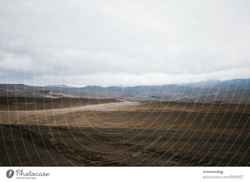 I'm in Iceland. Natur Ferien & Urlaub & Reisen Einsamkeit Landschaft Wolken Berge u. Gebirge Sand Felsen Erde trist Urelemente Hügel Spuren Island