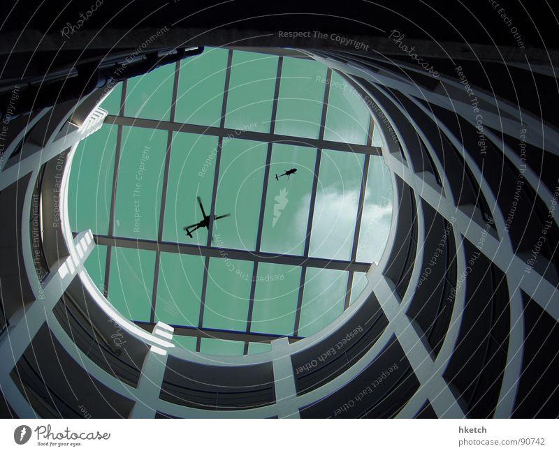 Black Helicopters Hubschrauber schwarz Verschwörung Licht Himmel Beton Parkhaus Garnspulen rund Autobahnauffahrt Detailaufnahme gefährlich Luftverkehr