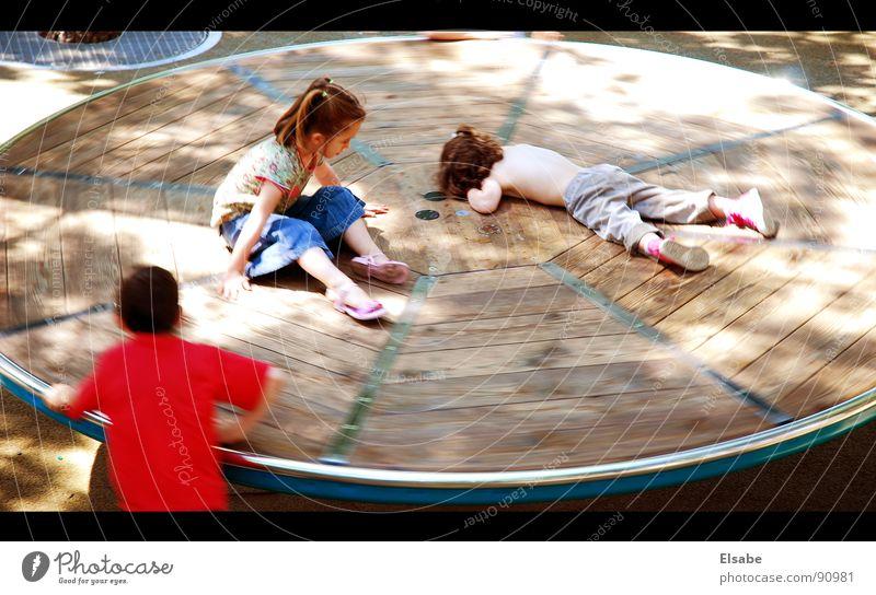 Sonntag Kind Sonne Spielen lustig Freizeit & Hobby Paris Jahrmarkt Spielplatz Karussell Sonnenfleck