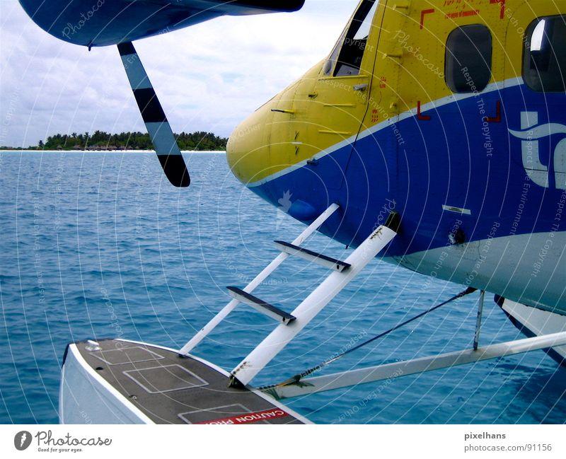Airtaxi Strand Meer Insel Güterverkehr & Logistik Luftverkehr Wasser Wolken Küste Flugzeug Wasserflugzeug blau gelb Malediven Indischer Ozean Farbfoto