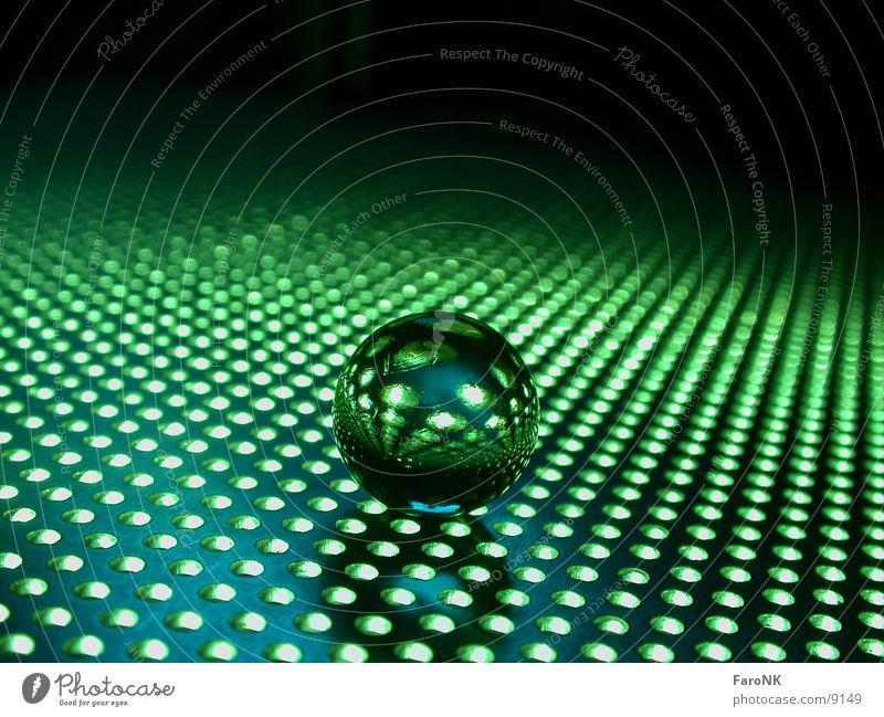 GrüneKugel grün Murmel Loch Makroaufnahme Nahaufnahme Glas
