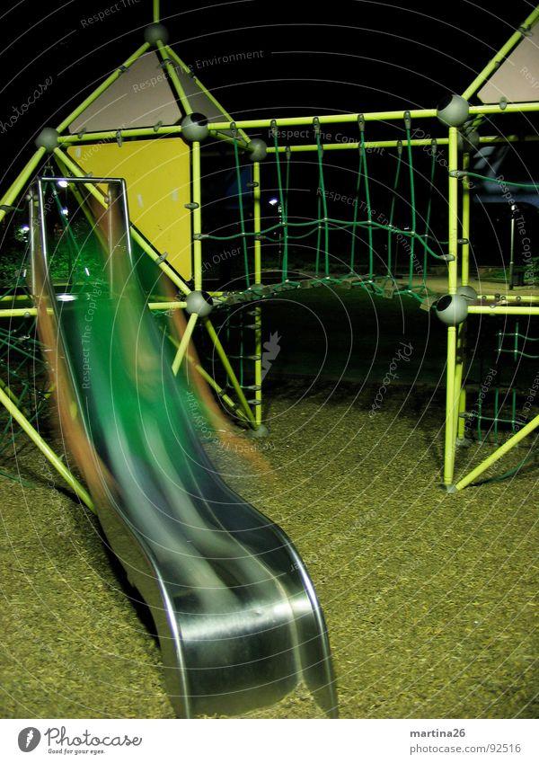 Geisterrutsche Nacht dunkel Spielplatz Rutsche Unschärfe Geister u. Gespenster Langzeitbelichtung Freude Aktion Spielen Mensch Klettergerüst night dark fun