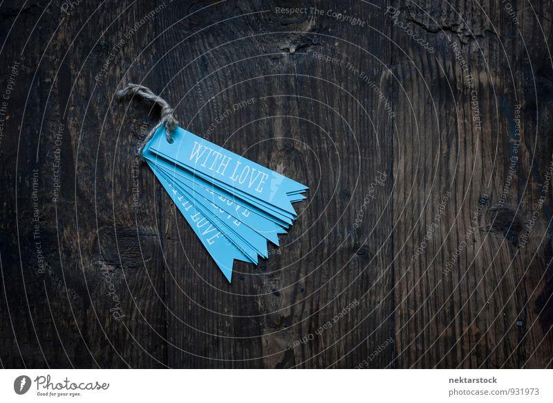 blaue Anhänger auf Holzuntergrund Liebe Hintergrundbild Business Design Papier altehrwürdig Zettel Etikett Musiknoten Schreibwaren Valentinstag