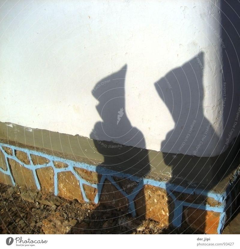 Schattenmänner Mann Sonne dunkel Wand Tod Mauer hell Bekleidung Afrika Vergänglichkeit Spitze Mütze Putz Kapuze Tracht Marokko