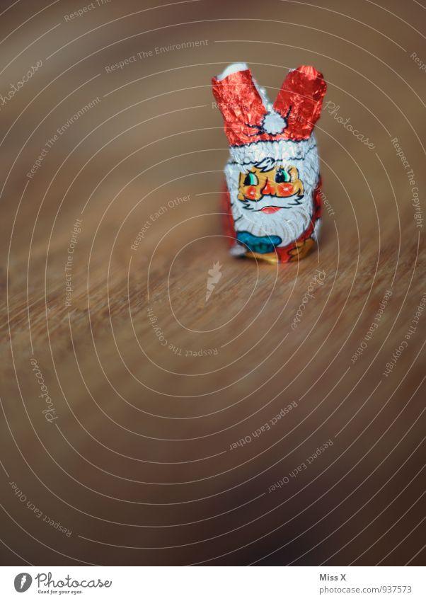 Recycling Lebensmittel Süßwaren Schokolade Ernährung Weihnachten & Advent 1 Mensch Tier alt süß Wandel & Veränderung Weihnachtsmann Mogelpackung betrügen