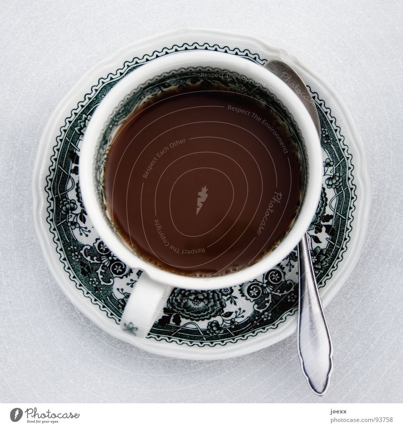 Kaffee bei Oma Besteck braun Café Erholung Erinnerung Geschirr grün Tragegriff Kaffeepause Kaffeelöffel Kaffeetasse Furche Koffein Löffel Muster Nachmittag