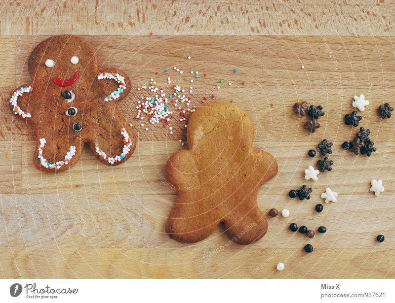 Lebkuchenmann Lebensmittel Ernährung Lächeln niedlich süß lecker Süßwaren Backwaren Schokolade Teigwaren Keks Plätzchen Weihnachtsdekoration Weihnachtsgebäck
